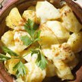 Potatoes with Four Cheeses in a Clay Pot
