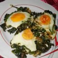Eggs Sunny Side Up on a Bed of Dock and Spinach