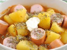 Potatoes with Sausages in a Clay Pot