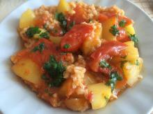 Rice with Potatoes and Tomatoes in the Oven
