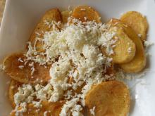 French Fries Cooked in Butter and with Feta Cheese on Top