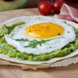 Eggs Sunny Side Up on a Bed of Avocado