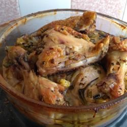 Chicken Legs in a Glass Cook Pot with Onions