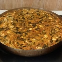 Dock with Eggs and Feta Cheese in the Oven