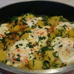Stewed Potatoes with Eggs Under a Lid