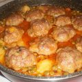 Meatballs with Peas and Potatoes in the Oven
