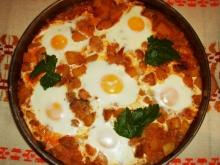 Eggplant Moussaka with Meat and Eggs Sunny Side Up
