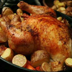 Chicken Stuffed with Rice and Garnished with Potatoes
