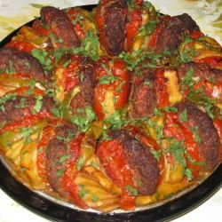Meatballs with Potatoes and Tomatoes in the Oven