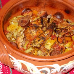 New Year`s Clay Pot Dish with 2 Kinds of Meat and Sausage