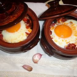 Clay Pots with Potatoes and Various Meats