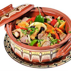 Clay pot dish with mushrooms and hot peppers