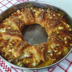 Pizza Wreath with Cheese, Feta Cheese, Sausages and Chutney