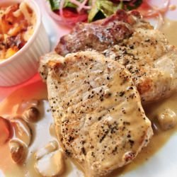 Pork Steaks with Mushrooms and Smoked Cheese